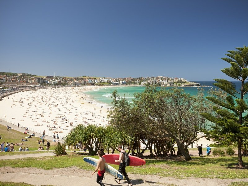 bondi beach view with two men's with surfboard