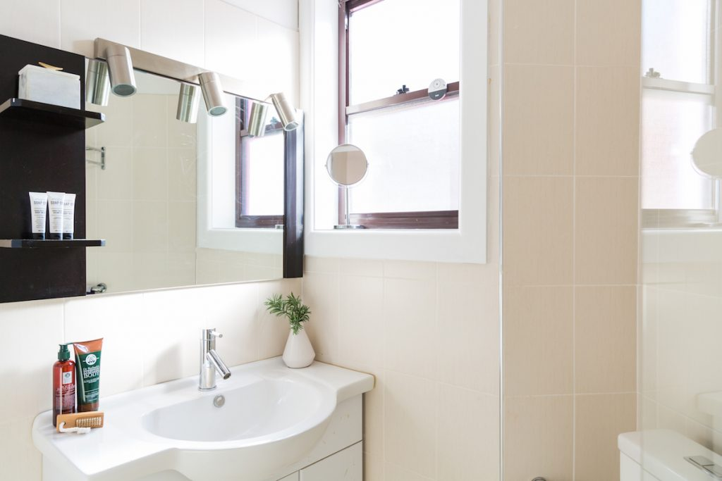bondi beach house bath room vanity mirror and sink