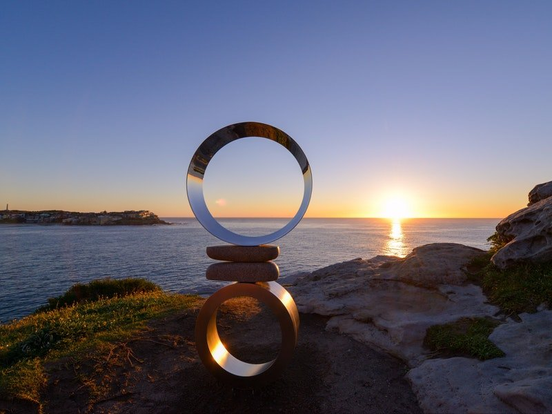 bondi sunset with sculpture display